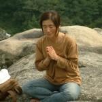 Woman meditating in Seoul